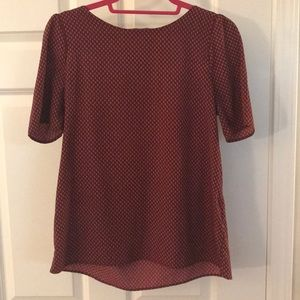 Red short sleeve blouse with white detail
